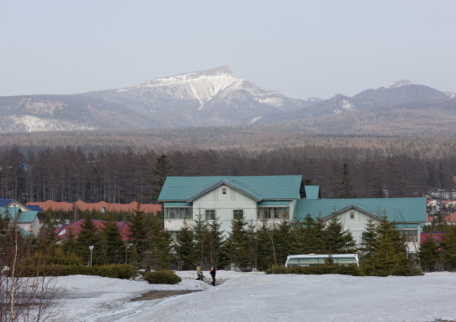 New apartment houses in the snow with a view on mount Paektu, Ryanggang Province, Samjiyon, North Korea