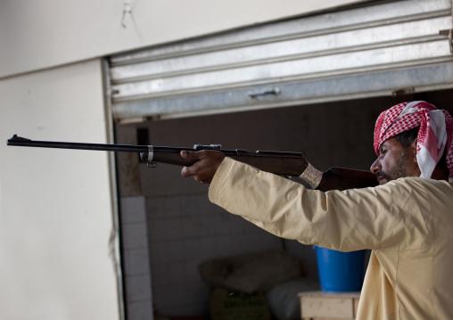 Man Testing A Gun In The Weapons Souk, Sinaw, Oman