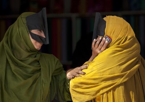 Two Bedouin Women Talking In Mobile Phone, Sinaw, Oman