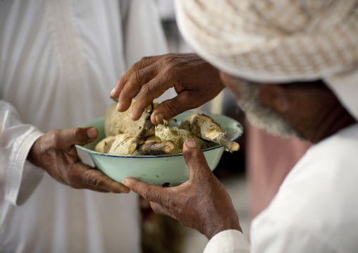 Men Sharing Honey In Sinaw Market, Oman