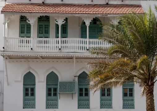 Old Omani White House With Green Carved Wooden Windows And Palm Tree, Muscat, Oman
