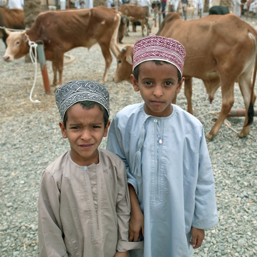 Two Kids In Traditional Costumes At Nizwa Market, Oman