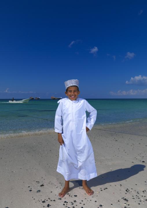 Boy Standing On The Beach Happily, Masirah Island, Oman