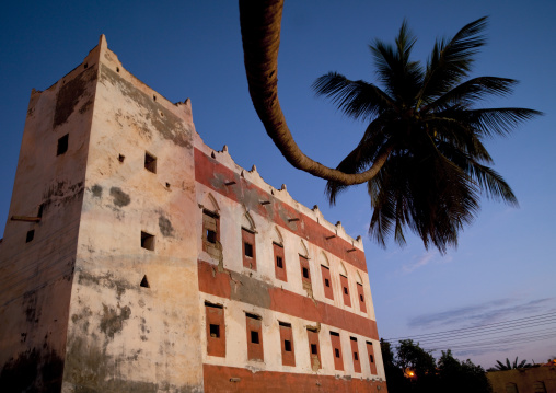 Old Red House In Rose Color  With A Palm Tree, Salalah, Oman