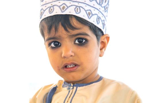Omani boy in traditional clothing with kohl on his eyes, Ad Dakhiliyah Region, Nizwa, Oman