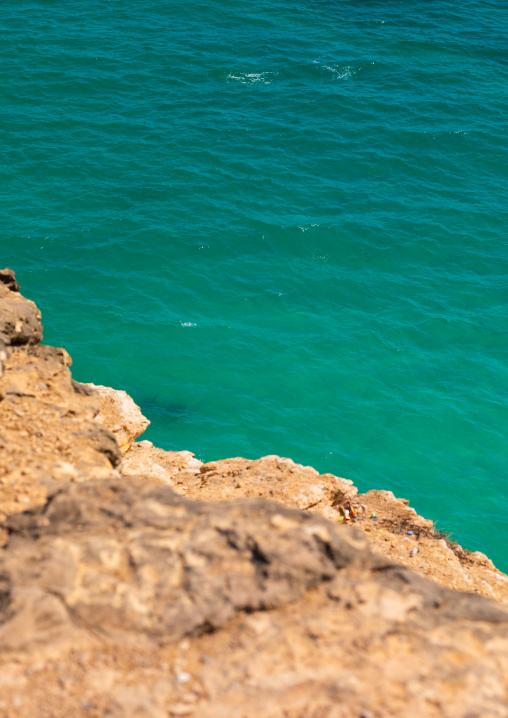 Cliff over the green water, Dhofar Governorate, Taqah, Oman