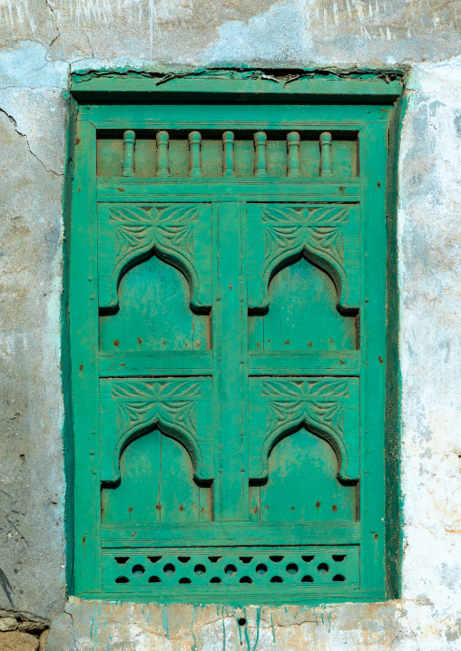 Wooden carved window of an abandoned house, Dhofar Governorate, Mirbat, Oman