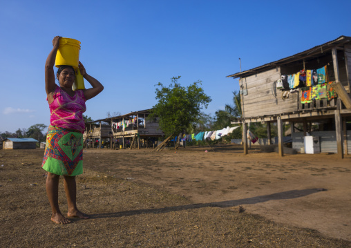Panama, Darien Province, Alto Playona, Woman Of The Native Indian Embera Tribe Carrying Water On The Head