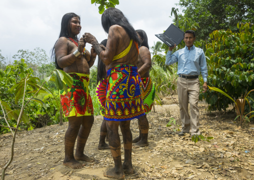 Panama, Darien Province, Bajo Chiquito, Embera Indians In Traditional Clothing Dancing On The Sound Of A Computer
