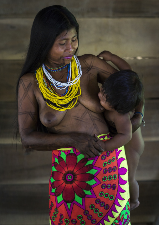Panama, Darien Province, Bajo Chiquito, Woman Of The Native Indian Embera Tribe Breastfeeding Her Baby