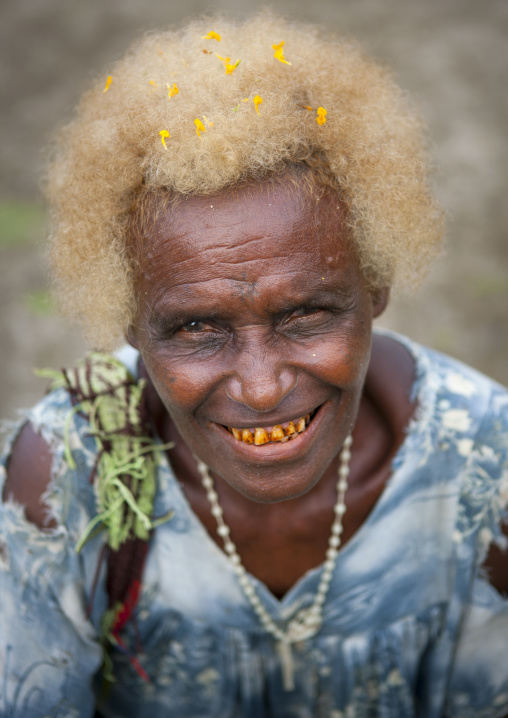 Old woman with pollens in her blonde hair, New Ireland Province, Langania, Papua New Guinea