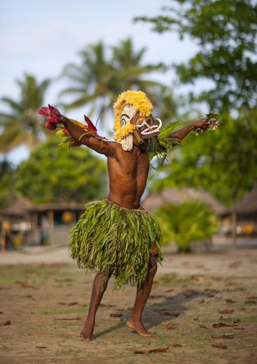 Malagan tatuana masks dance during a funeral ceremony, New Ireland Province, Langania, Papua New Guinea