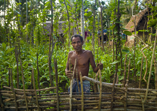 Man in his farm, Milne Bay Province, Trobriand Island, Papua New Guinea