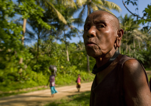 Old mourning woman with shaved head, Milne Bay Province, Trobriand Island, Papua New Guinea