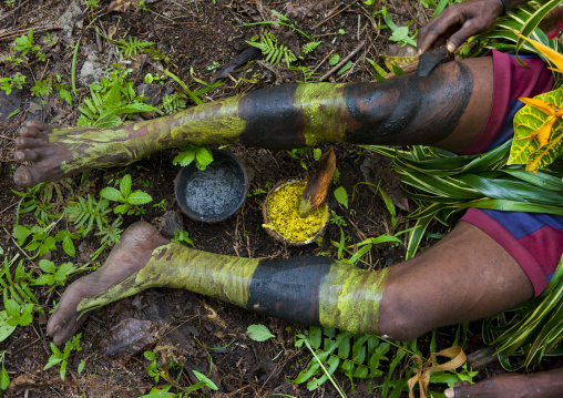 Witchdoctor legs with makeup in the jungle, New Ireland Province, Kavieng, Papua New Guinea