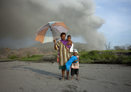 Family under a volcanic eruption in tavurvur volcano, East New Britain Province, Rabaul, Papua New Guinea