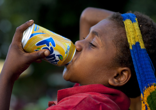 Boy drinking fanta can, East New Britain Province, Rabaul, Papua New Guinea