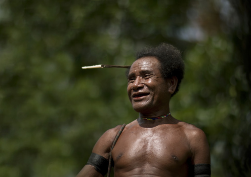 Traditional chief with a betel smile, Milne Bay Province, Trobriand Island, Papua New Guinea