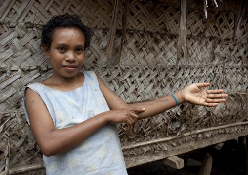 Islander girl showing tattos on her arm, Milne Bay Province, Trobriand Island, Papua New Guinea