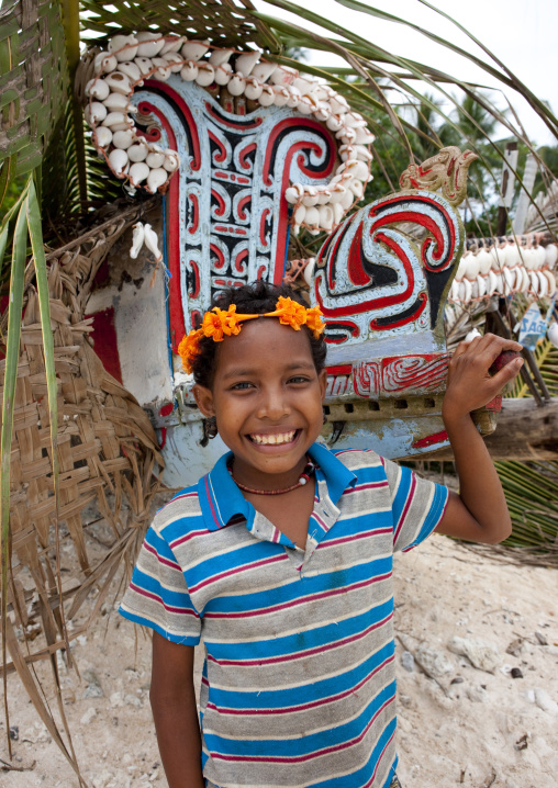 Girl in front of a kula canoe decorated with shells, Milne Bay Province, Trobriand Island, Papua New Guinea