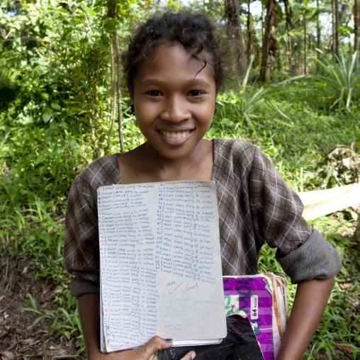 Islander girl with school works, Milne Bay Province, Trobriand Island, Papua New Guinea