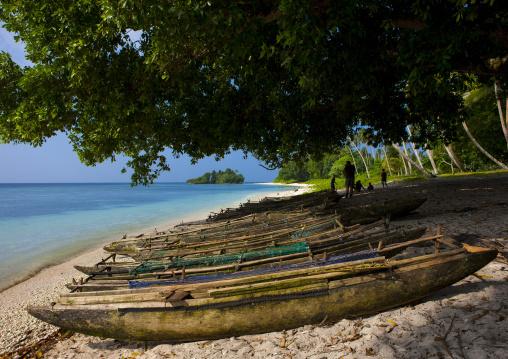 Boats on beautiful deserted kaibola beach, Milne Bay Province, Trobriand Island, Papua New Guinea