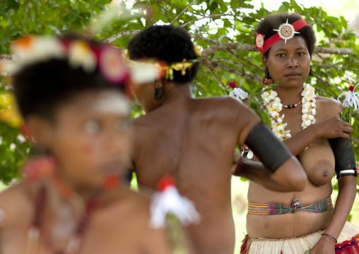 Tribal women ready for a ceremony, Milne Bay Province, Trobriand Island, Papua New Guinea
