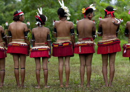 Portrait of topless tribal women in traditional clothing, Milne Bay Province, Trobriand Island, Papua New Guinea