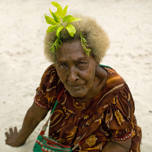 Old woman with blonde hair, New Ireland Province, Kavieng, Papua New Guinea
