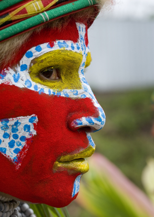 Melpa tribe woman with traditional makeup during a sing sing, Western Highlands Province, Mount Hagen, Papua New Guinea