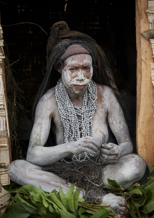 Portrait of a mourning woman with job tears necklaces, Western Highlands Province, Mount Hagen, Papua New Guinea