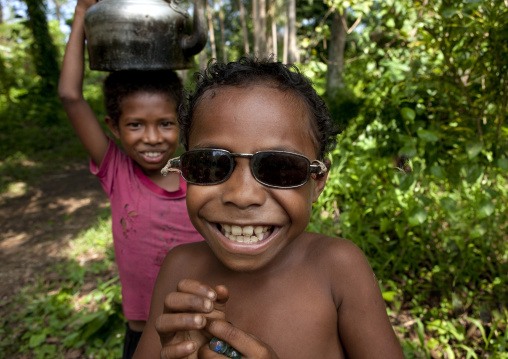 Boy wearing sunglasses, Milne Bay Province, Trobriand Island, Papua New Guinea