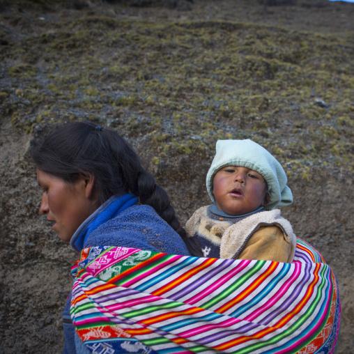 Peruvian Mother And Baby Climbing To The Qoyllur Riti Festival, Ocongate Cuzco, Peru