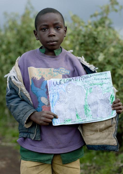 Rwandan boy showing his gorilla drawing in volcanoes national park area, Lake Kivu, Ibwiwachu, Rwanda