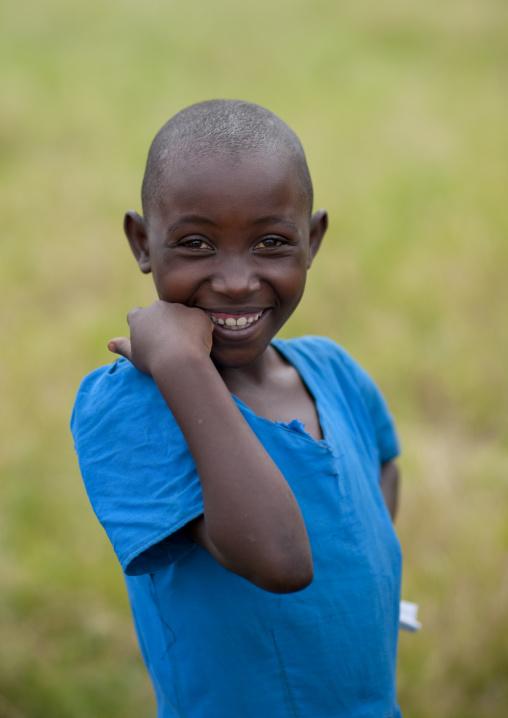 Smiling rwandan pupil outside of a school, Lake Kivu, Gisenye, Rwanda