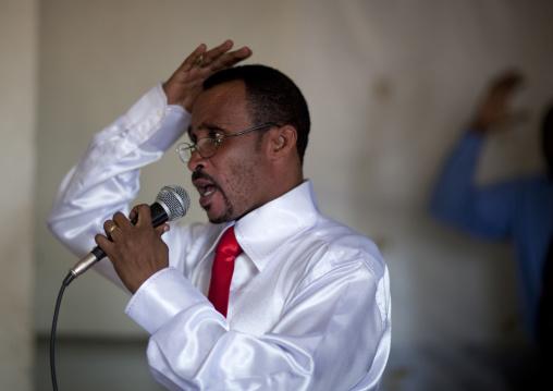 Rwandan man singing during a sunday mass in a church, Kigali Province, Kigali, Rwanda