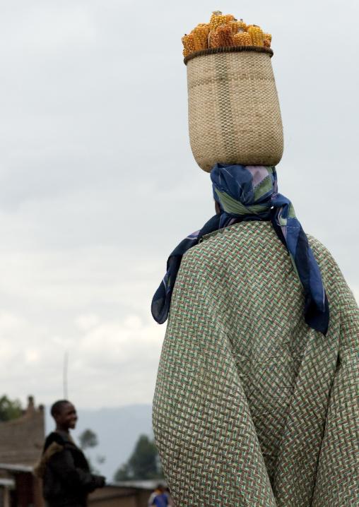 Woman carrying a basket on her head, Northwest Province, Rehengeri, Rwanda