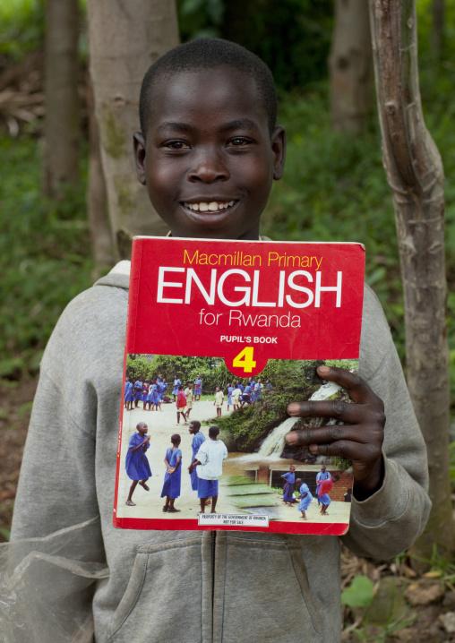 Rwandan boy with an english course book, Northwest Province, Rehengeri, Rwanda