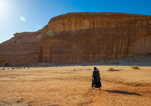 Saudi woman in niqab in the desert of Madain Saleh, Al Madinah Province, Alula, Saudi Arabia
