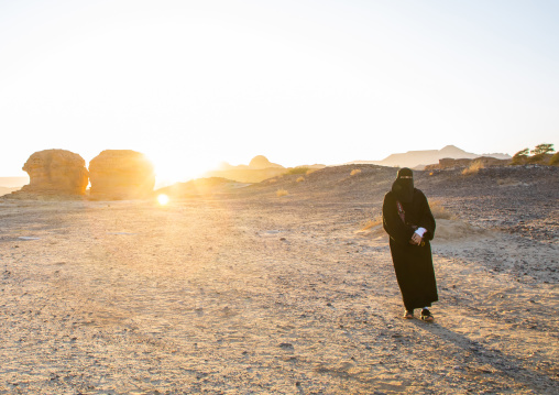 Saui woman in niqab in the desert of Madain Saleh, Al Madinah Province, Alula, Saudi Arabia