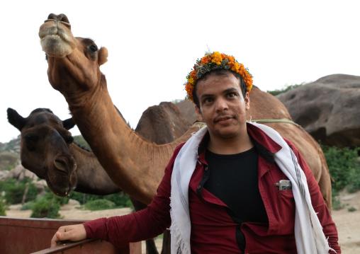 Portrait of a saudi flower man with camels, Jizan province, Alaydabi, Saudi Arabia