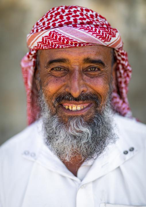 Portrait of a smiling saudi man wearing a keffiyeh, Jizan province, Addayer, Saudi Arabia