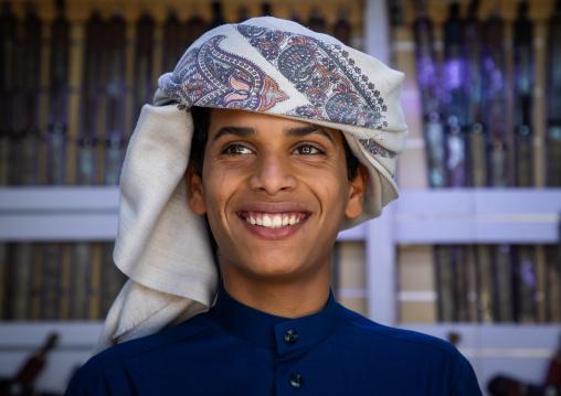 Portrait of a smiling saudi young man, Najran Province, Najran, Saudi Arabia
