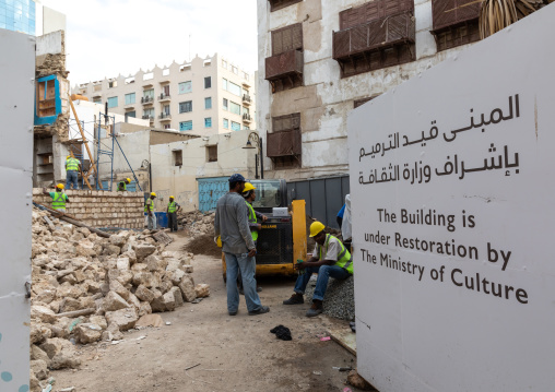 Workers restoring an old house with wooden mashrabiyas in al-Balad quarter, Mecca province, Jeddah, Saudi Arabia