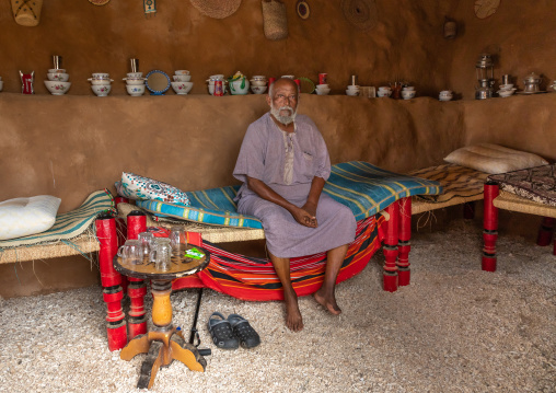 Saudi man sit insidea traditional house, Red Sea, Farasan, Saudi Arabia