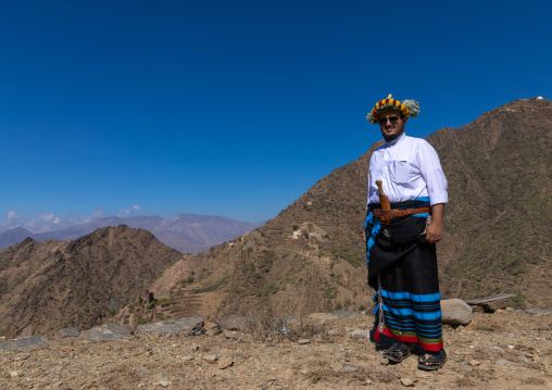 Portrait of a flower man wearing a floral crown on the head in the mountain, Jizan Province, Addayer, Saudi Arabia