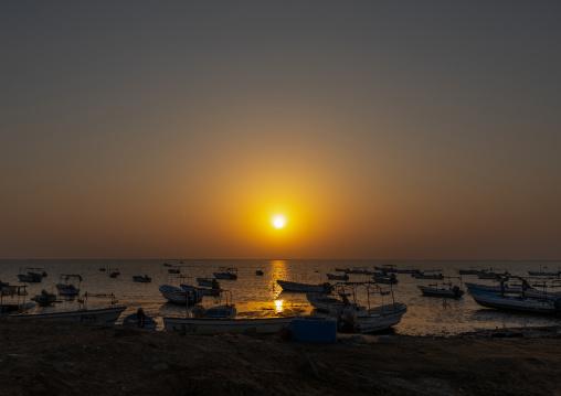 Sunset on a port full of boats, Jizan Province, Sabya, Saudi Arabia