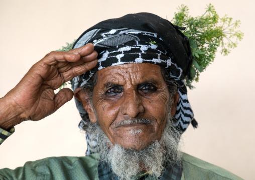 Portrait of a flower man wearing a floral crown on the head, Jizan Province, Mahalah, Saudi Arabia