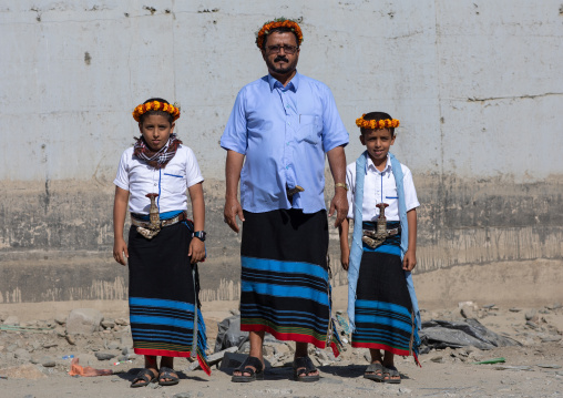 Portrait of a flower man with his sons wearing floral crowns on the heads, Jizan Province, Addayer, Saudi Arabia