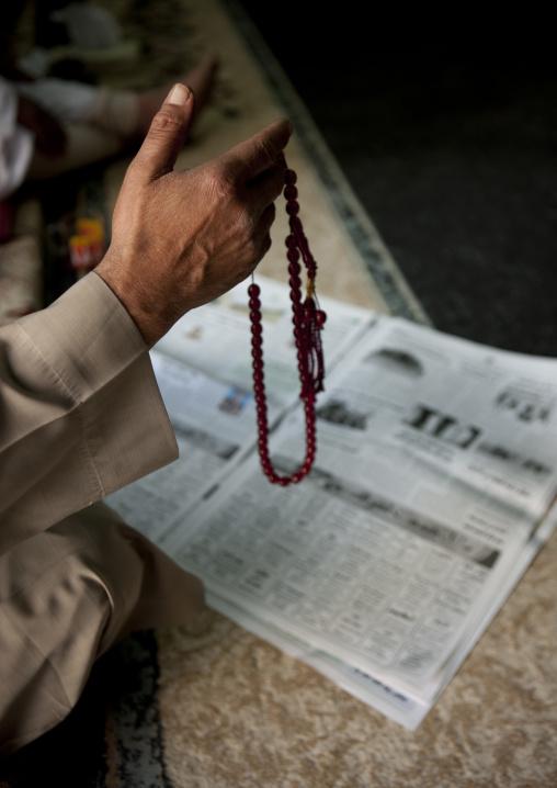 Saudi man with a prayer beads, Al-Jawf Region, Al-Jawf, Saudi Arabia